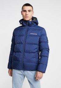 Calvin Klein Jeans - HOODED DOWN PUFFER  - Vinterjakke - blue - 0