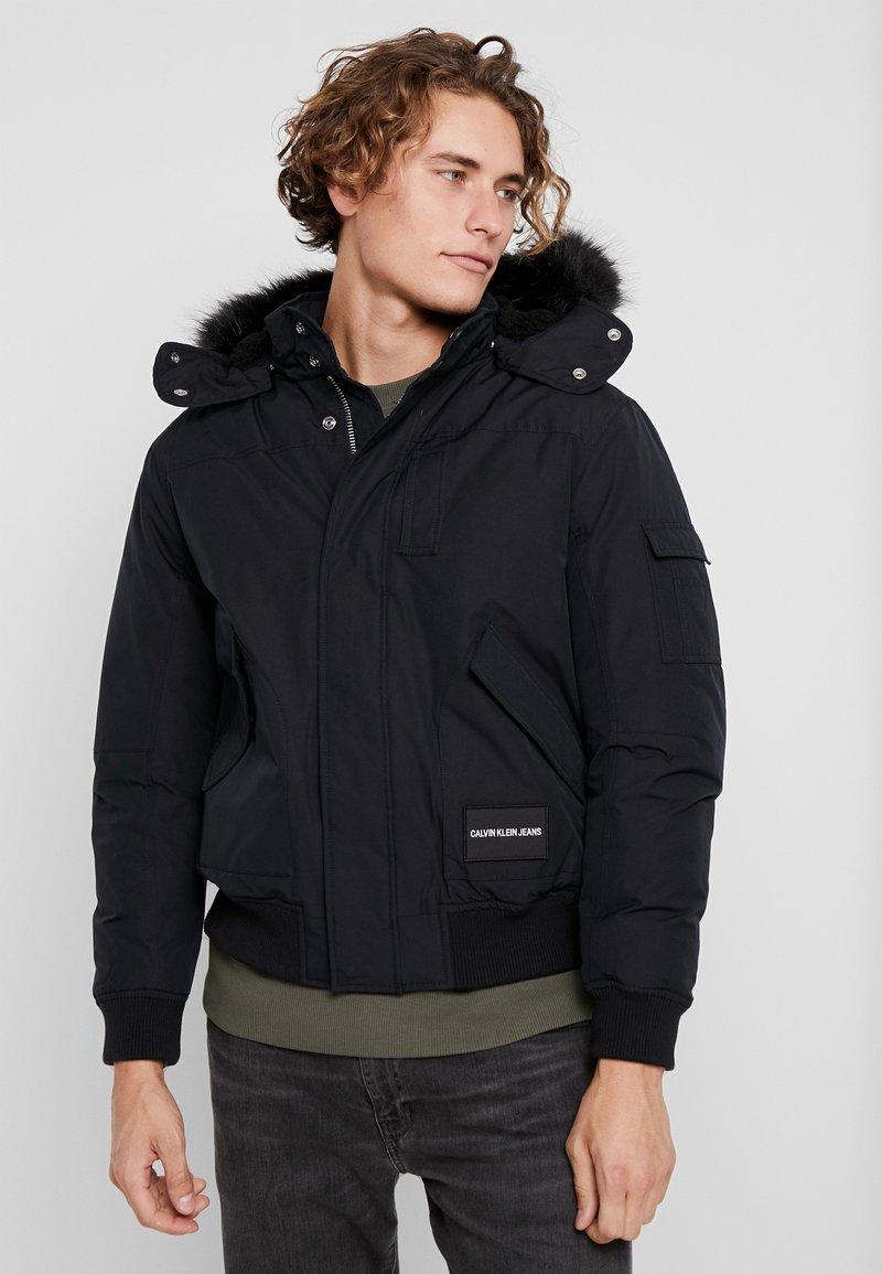 Calvin Klein Jeans - FUR TRIMMED HOODED DOWN BOMBER - Down jacket - black