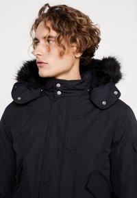 Calvin Klein Jeans - FUR TRIMMED HOODED DOWN BOMBER - Down jacket - black - 3