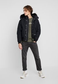 Calvin Klein Jeans - FUR TRIMMED HOODED DOWN BOMBER - Down jacket - black - 1
