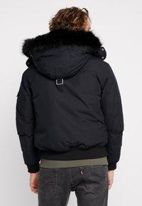Calvin Klein Jeans - FUR TRIMMED HOODED DOWN BOMBER - Untuvatakki - black - 2