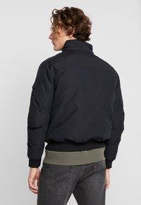 Calvin Klein Jeans - FUR TRIMMED HOODED DOWN BOMBER - Down jacket - black - 5
