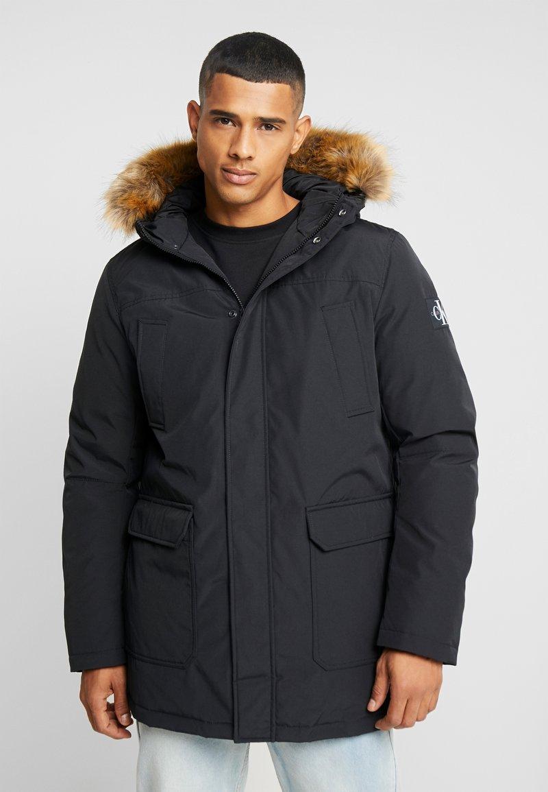 Calvin Klein Jeans - TRIMMED HOODED PADDED  - Dunfrakker - black