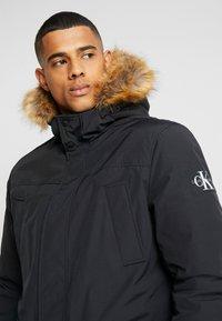 Calvin Klein Jeans - TRIMMED HOODED PADDED  - Dunfrakker - black - 3