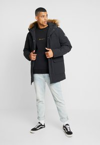 Calvin Klein Jeans - TRIMMED HOODED PADDED  - Dunfrakker - black - 1