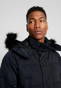 Calvin Klein Jeans - Daunenmantel - black - 7