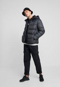Calvin Klein Jeans - MONOGRAM PADDED JACKET - Talvitakki - black - 1