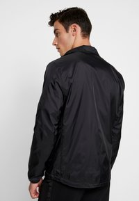 Calvin Klein Jeans - HARRINGTON - Lehká bunda - black - 2
