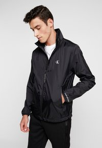Calvin Klein Jeans - HARRINGTON - Lehká bunda - black - 0