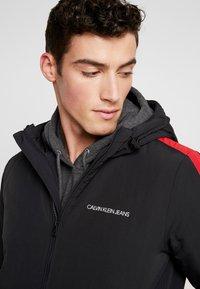 Calvin Klein Jeans - PADDED JACKET - Vinterjacka - black/racing red - 6