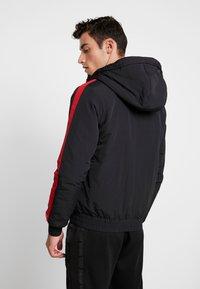Calvin Klein Jeans - PADDED JACKET - Vinterjacka - black/racing red - 2