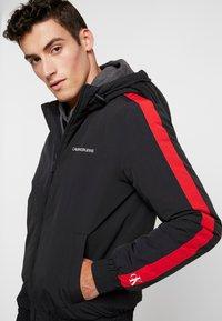 Calvin Klein Jeans - PADDED JACKET - Vinterjacka - black/racing red - 3