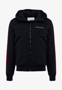 Calvin Klein Jeans - PADDED JACKET - Vinterjacka - black/racing red - 5