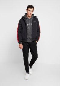 Calvin Klein Jeans - PADDED JACKET - Vinterjacka - black/racing red - 1
