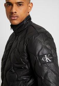 Calvin Klein Jeans - QUILTED JACKET - Bomberjacks - black - 4