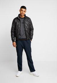 Calvin Klein Jeans - QUILTED JACKET - Bomberjacks - black - 1