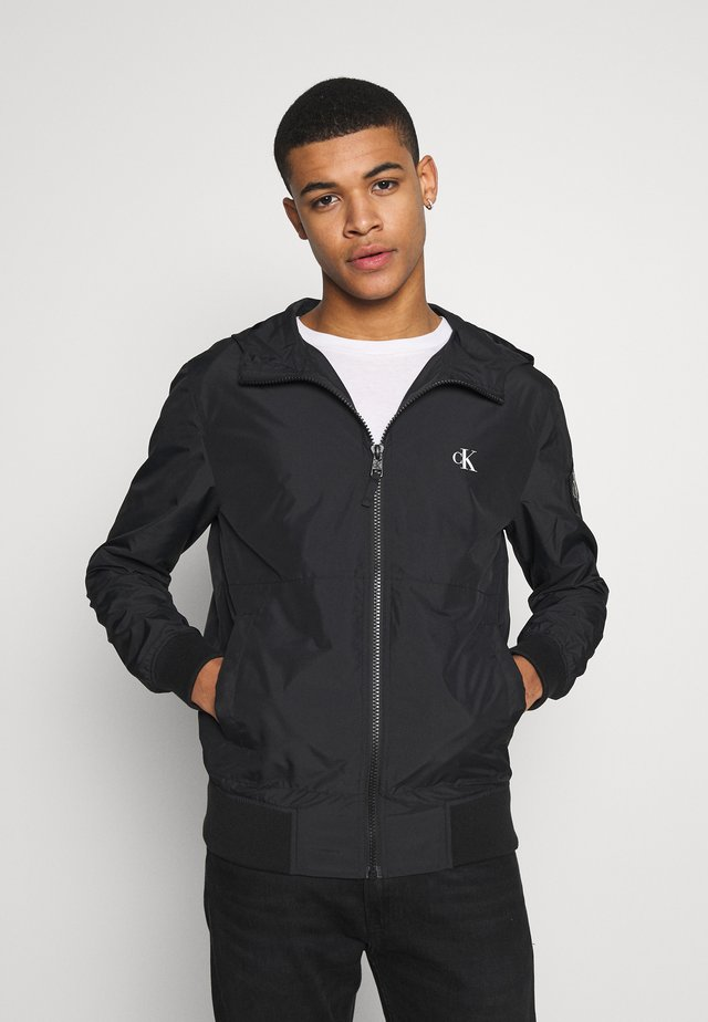 HOODED BLOCKING NYLON JACKET - Summer jacket - black/white