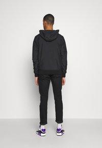 Calvin Klein Jeans - HOODED BLOCKING NYLON JACKET - Kevyt takki - black/white - 2