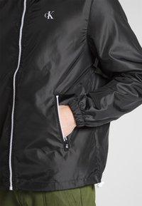 Calvin Klein Jeans - ZIP THROUGH HD JACKET - Kevyt takki - black - 3