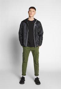 Calvin Klein Jeans - ZIP THROUGH HD JACKET - Kevyt takki - black - 1
