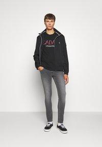 Calvin Klein Jeans - ZIP UP HARRINGTON - Veste légère - black - 1