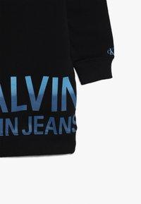 Calvin Klein Jeans - STAMP LOGO DRESS - Denní šaty - black - 4