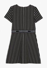 Calvin Klein Jeans - CITY STRIPE DRESS - Trikoomekko - black - 1