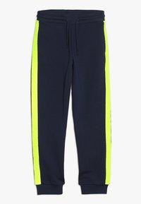 Calvin Klein Jeans - NEON TAPE  - Teplákové kalhoty - blue - 0