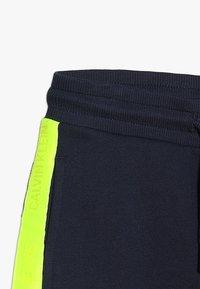 Calvin Klein Jeans - NEON TAPE  - Teplákové kalhoty - blue - 3