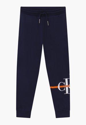 MONOGRAM STRIPE  - Pantalones deportivos - blue