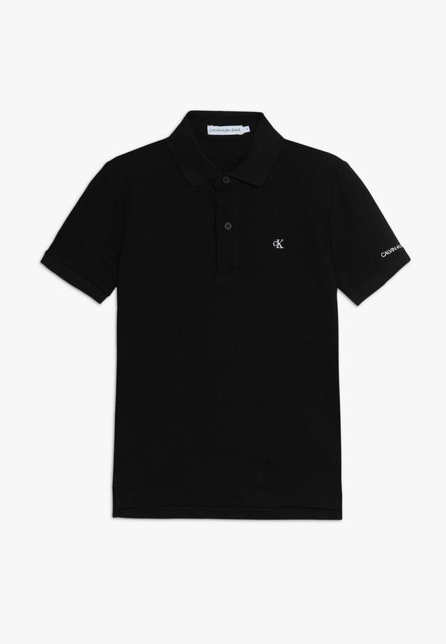 ESSENTIAL - Poloshirt - black