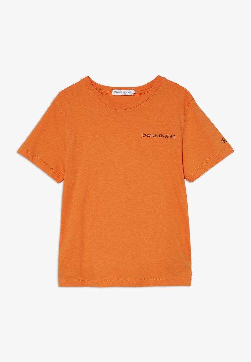 Calvin Klein Jeans - CHEST LOGO - Camiseta básica - orange