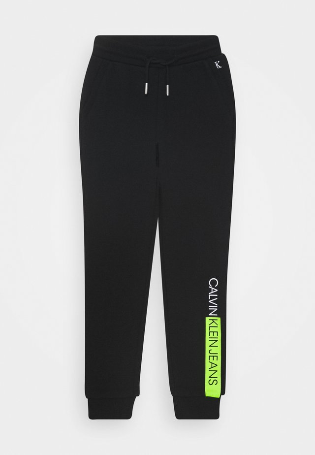 INSTITUTIONAL BLOCK - Tracksuit bottoms - black