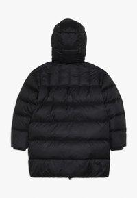 Calvin Klein Jeans - LOGO TAPE LONG JACKET - Doudoune - black - 1