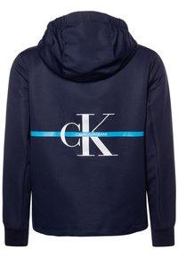 Calvin Klein Jeans - MONOGRAM STRIPE  - Chaqueta de entretiempo - blue - 1