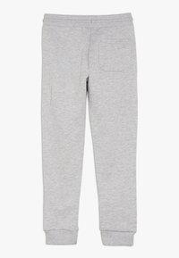 Calvin Klein Jeans - SIDE LOGO TAPE - Tracksuit bottoms - grey - 1