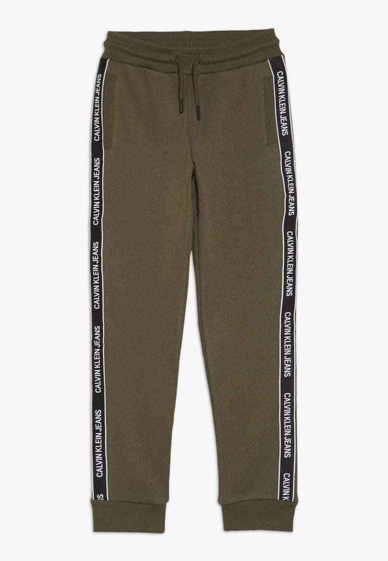 Calvin Klein Jeans - SIDE LOGO TAPE - Teplákové kalhoty - green