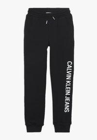 Calvin Klein Jeans - SOFT  - Teplákové kalhoty - black - 0
