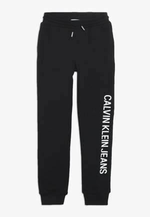 SOFT  - Tracksuit bottoms - black