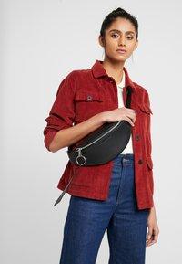Calvin Klein Jeans - BANNER STREETPACK - Gürteltasche - black - 1