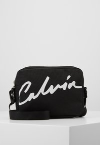 Calvin Klein Jeans - CKJ SPORT ESSENTIALS CAMERA BAG - Sac bandoulière - black - 0