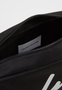 Calvin Klein Jeans - CKJ SPORT ESSENTIALS CAMERA BAG - Sac bandoulière - black - 4