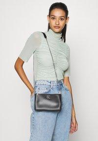 Calvin Klein Jeans - CROSSBODY CHAIN - Borsa a tracolla - black - 1