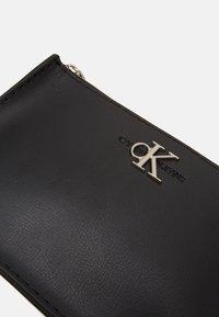 Calvin Klein Jeans - CROSSBODY CHAIN - Borsa a tracolla - black - 3