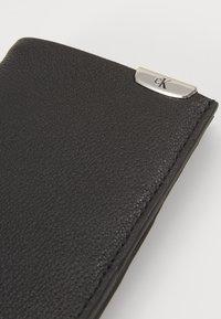 Calvin Klein Jeans - BILLFOLD - Lompakko - black - 2