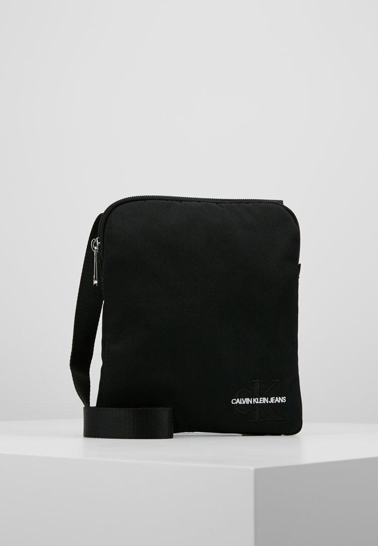 Calvin Klein Jeans - MONOGRAM MICRO FLATPACK - Across body bag - black