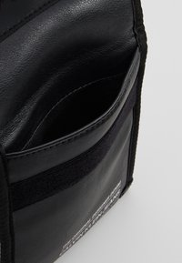 Calvin Klein Jeans - FEATHER WEIGHT FESTIVAL POUCH - Across body bag - black - 4
