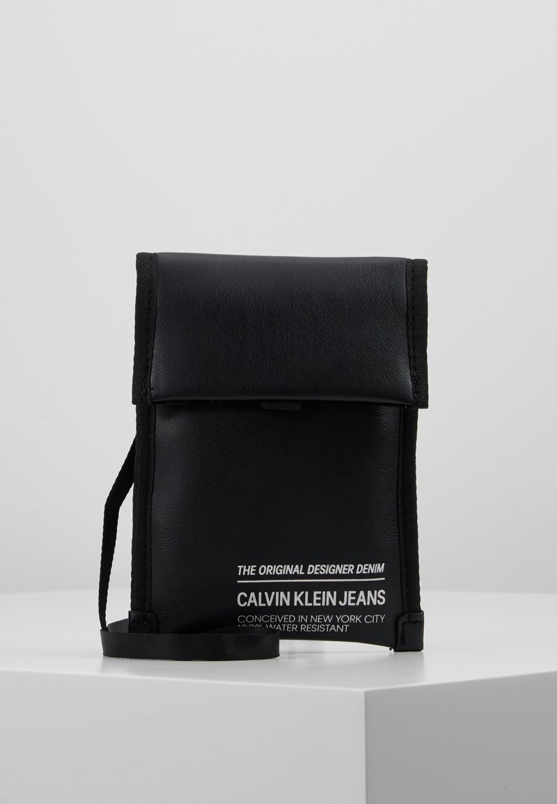 Calvin Klein Jeans - FEATHER WEIGHT FESTIVAL POUCH - Across body bag - black