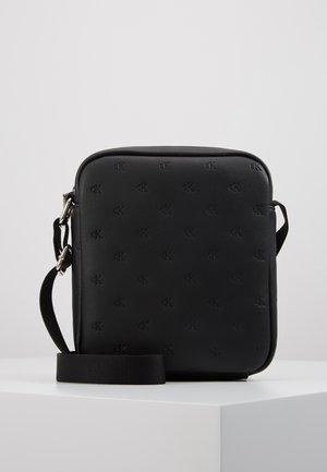 CKJ MONOGRAM EMBOSS MICRO FLTPCK - Across body bag - black
