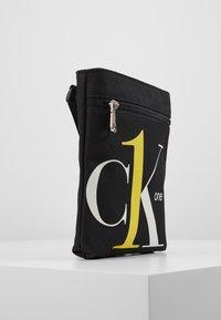 Calvin Klein Jeans - CK1 MICRO FLATPACK - Schoudertas - black - 2